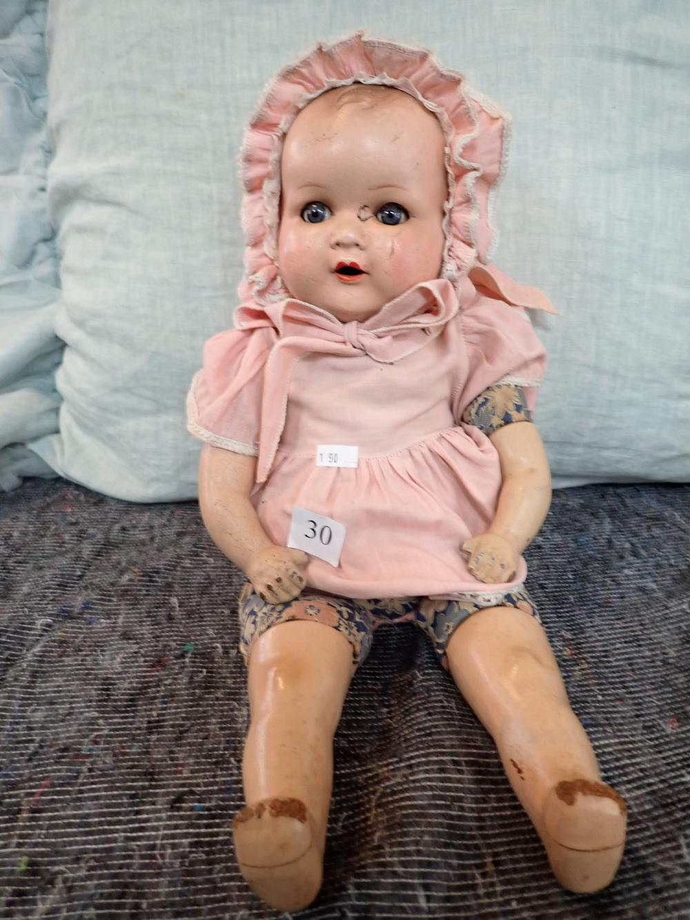 """18"""" AM GERMANY COMPOSITION DOLL, COMPOSITION HEAD, ARMS AND LEGS, SOME DAMAGE TO TOES ON FOOT, DAMAGE TO FACE NEAR RIGHT EYE, CLOTH BODY, VOICE BOX IN BACK OF BODY"""