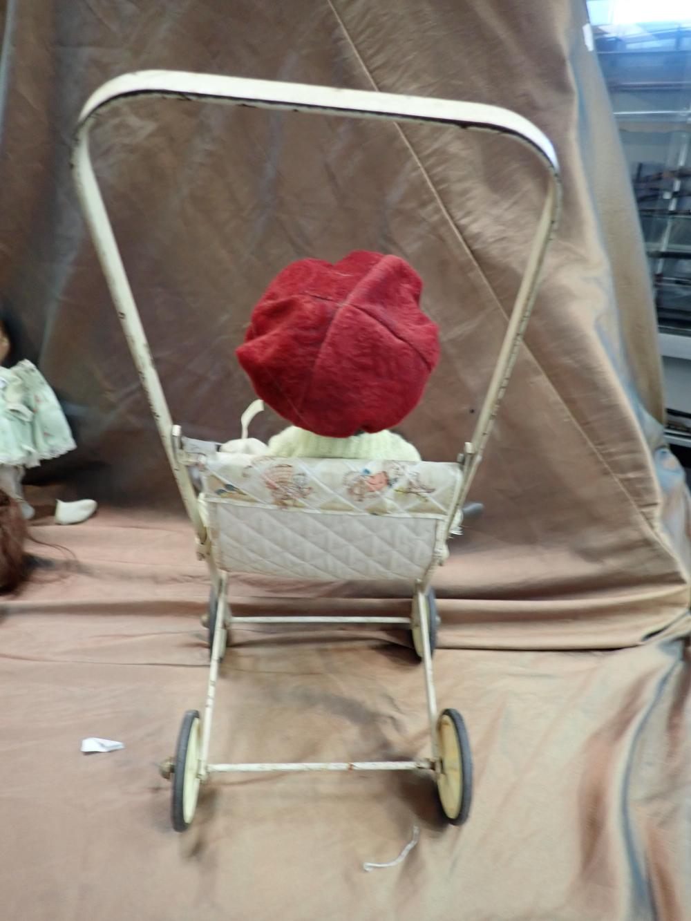 "18"" H X 8"" W DOLLS STROLLER METAL & PLASTIC WITH A 16"" REPRODUCTION PORCELAIN BROWN GIRL DOLL"