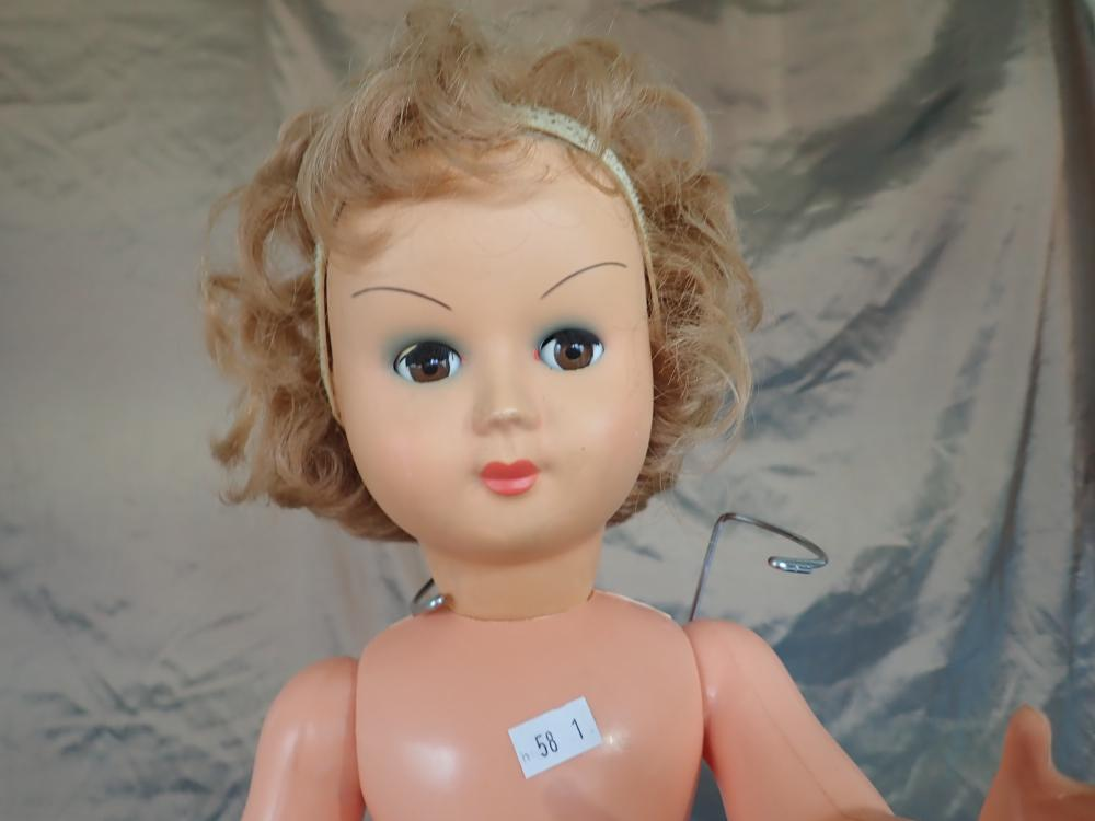 """3 DOLLS (1) 21 INCH PLASTIC RELIABLE DOLL CANADA (2) 22 INCH HARD PLASTIC DOLL WITH VOICE BOX TO THE FRONT, NO CLOTHES, DAMAGED TO UNDER SOLE OF FEET , BOTH WITH MOVEABLE EYES (3) REPRODUCTION MADE IN GERMANY BISQUE HEAD DOLL 18""""CLOTH BODY PART"""