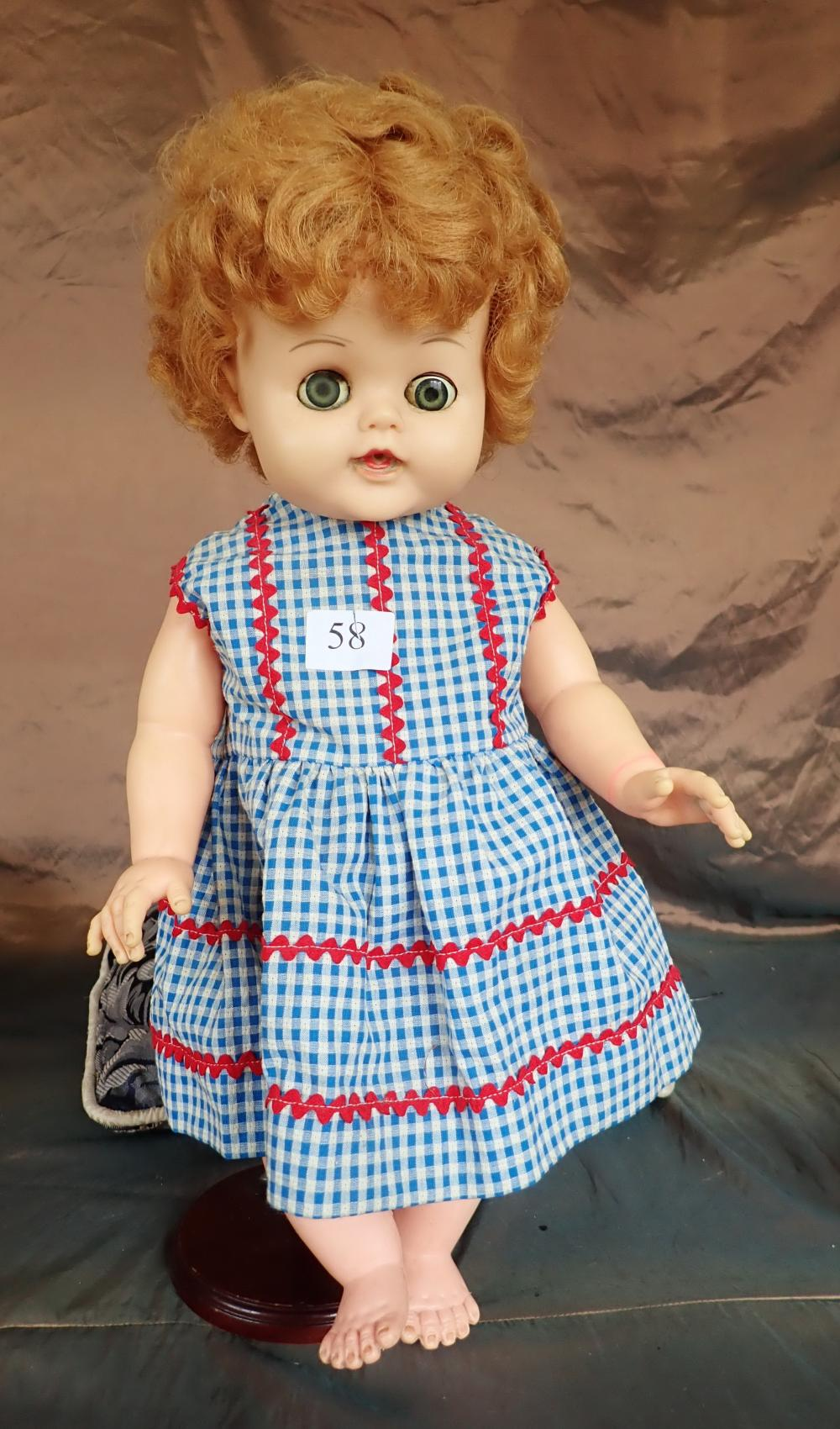 "3 DOLLS (1) 21 INCH PLASTIC RELIABLE DOLL CANADA (2) 22 INCH HARD PLASTIC DOLL WITH VOICE BOX TO THE FRONT, NO CLOTHES, DAMAGED TO UNDER SOLE OF FEET , BOTH WITH MOVEABLE EYES (3) REPRODUCTION MADE IN GERMANY BISQUE HEAD DOLL 18""CLOTH BODY PART"