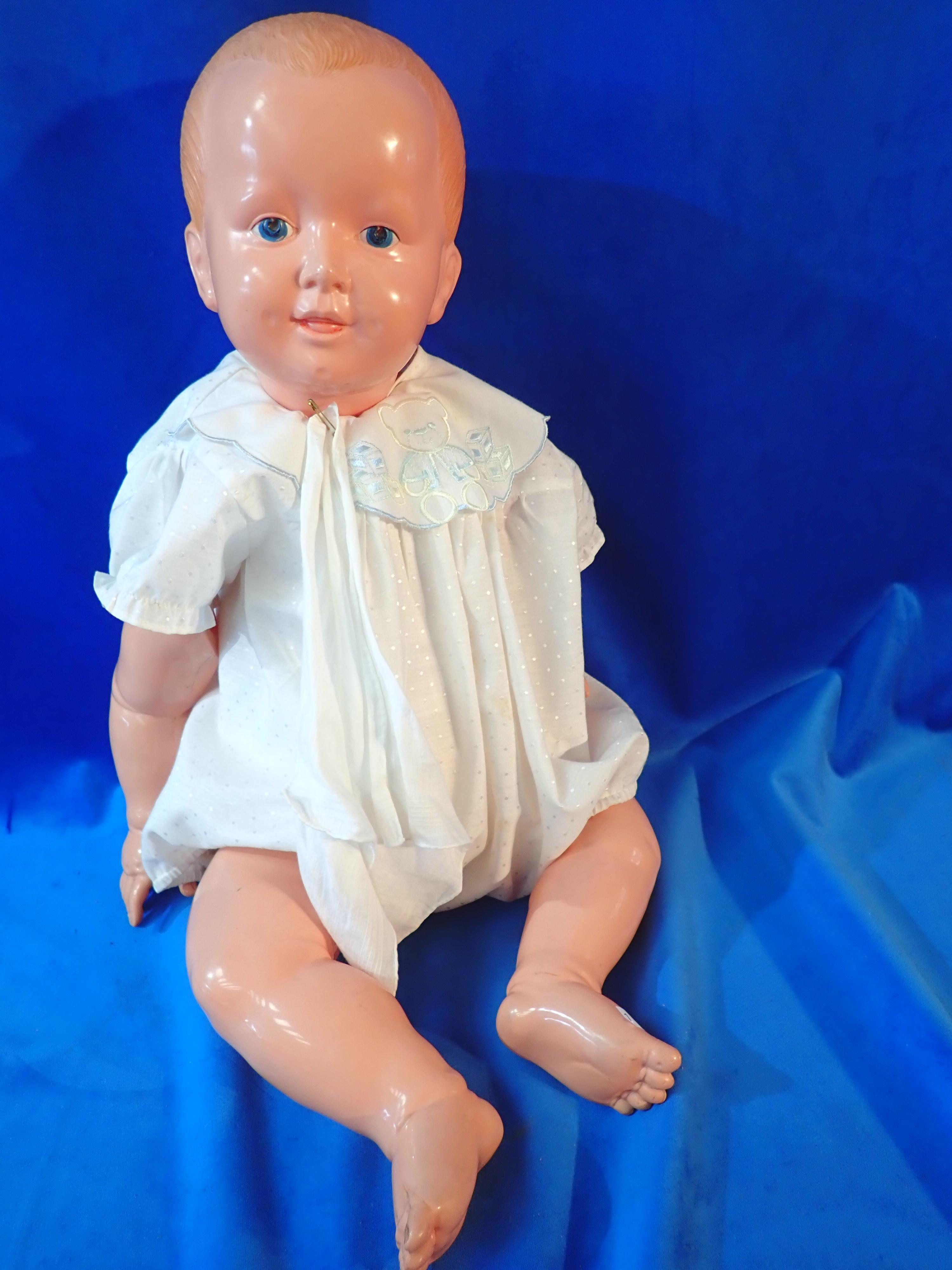 """20"""" LARGE CELLULOID DOLL IN BABY SUIT - MAKERS MARK K IN CLOVER LEAF - NEEDS RESTRINGING - OLD REPAIRS ON HAND"""
