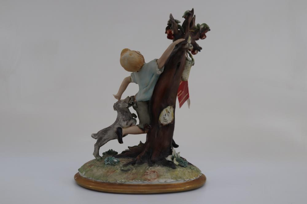 BOY IN TREE FIGURINE WITH CERTIFICATE 23CM