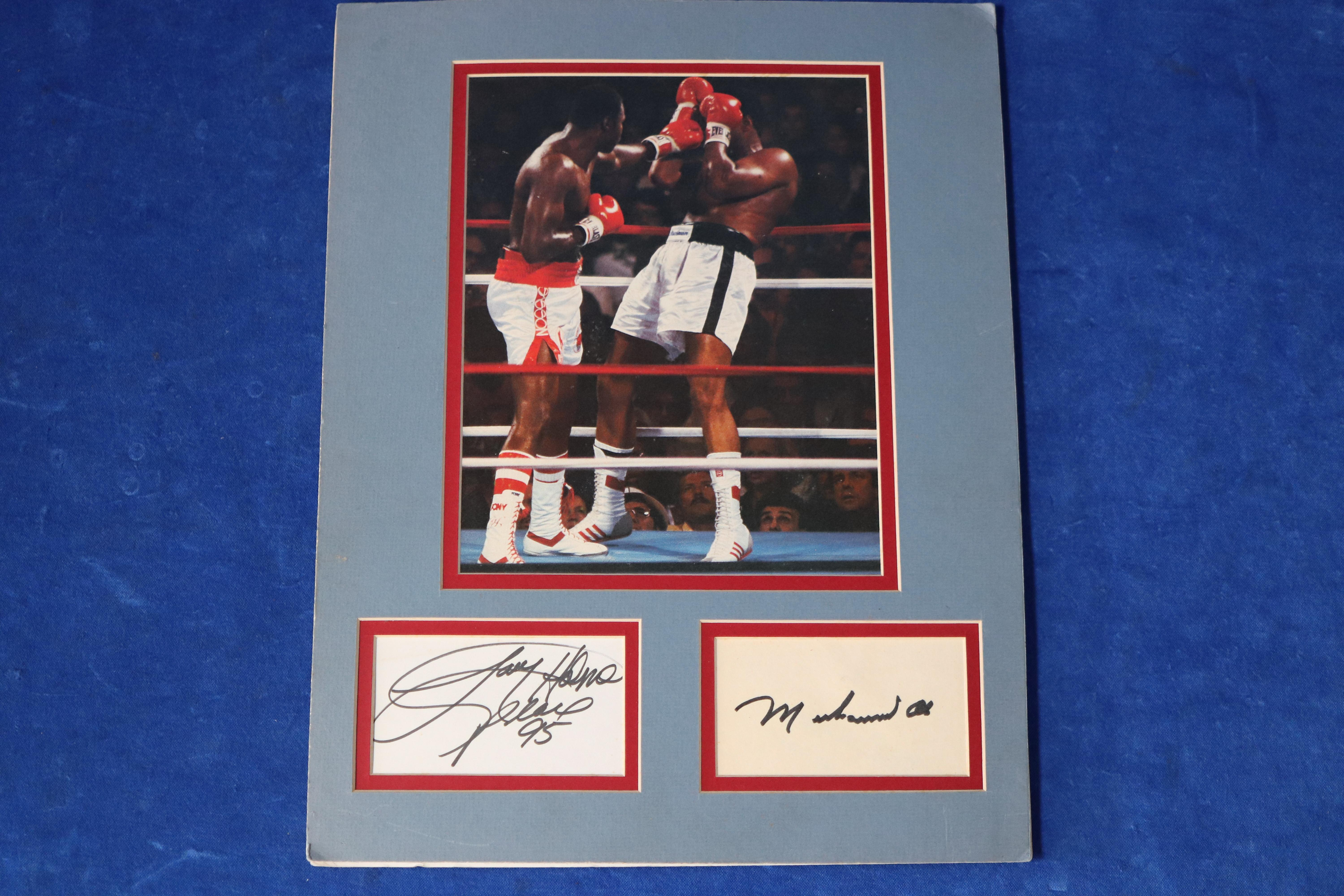 SIGNATURES, LARRY HOLMES (1995) AND MUHAMMED ALI, SEPARATE WITH PHOTO SCENE OF THEIR 1980 FIGHT (SIGNATURES UNVERIFIED)
