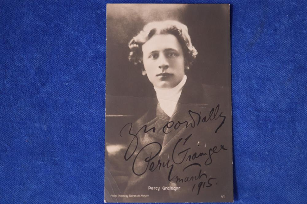 SIGNED PERCY GRAINGER POSTCARD, SIGNED WITH BLACK FOUNTAIN PEN, SEPITONE POSTCARD, SIGNED 'YOURS CORDIALLY PERCY GRAINGER MARCH 1915', AUTHENTICITY CERTIFICATE FROM AMAOLINE - 100115