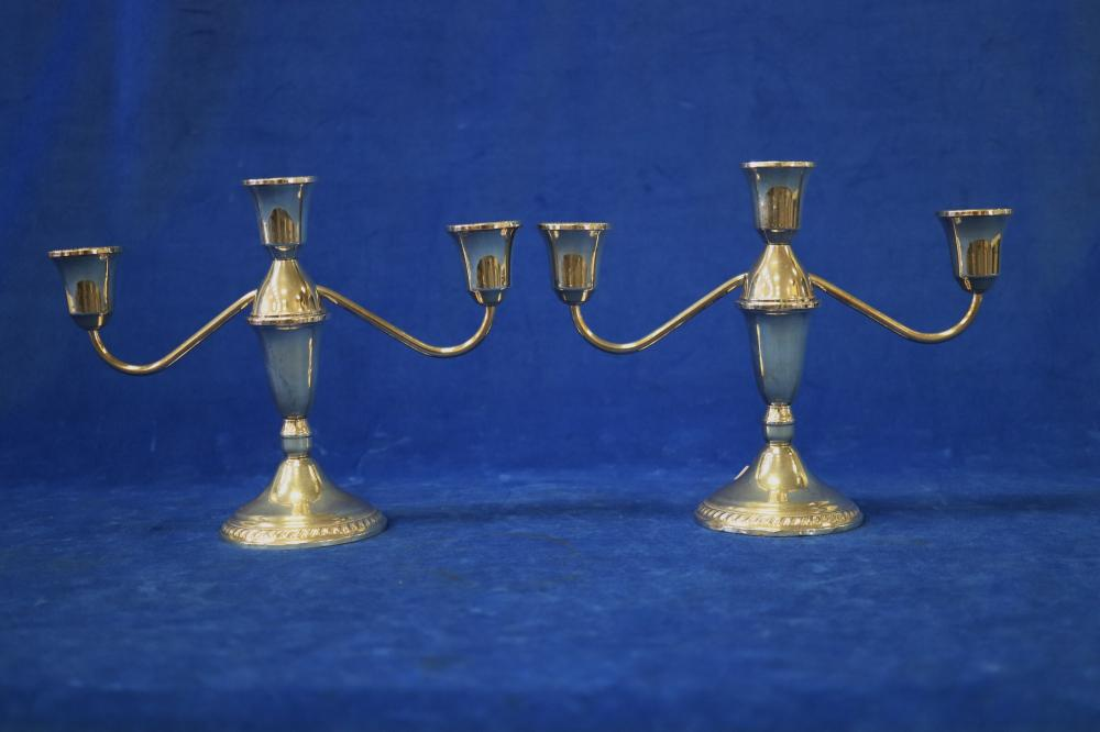 PAIR OF STERLING SILVER WEIGHTED CANDELABRA 16CM HIGH & 23 CM WIDE