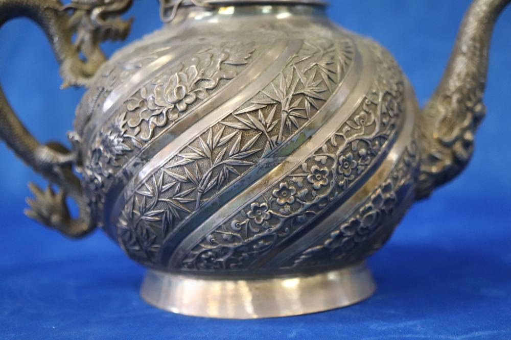 CHINESE EXPORT WARE SILVER TEAPOT, SIGNED BELOW, DRAGON LID AND HANDLE DECORATIONS, WITH BAMBOO AND DRAGONS TO BELLY, 24CM W, 505 GRAMS,