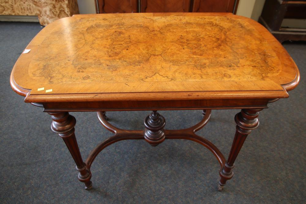 VICTORIAN BURR WALNUT SHAPED OBLONG CENTRE TABLE WITH TURNED AND FLUTED LEGS WITH A DOUBLE BOW STRETCHER RAIL C1870