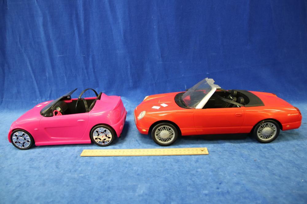 2 PLASTIC DOLL CARS