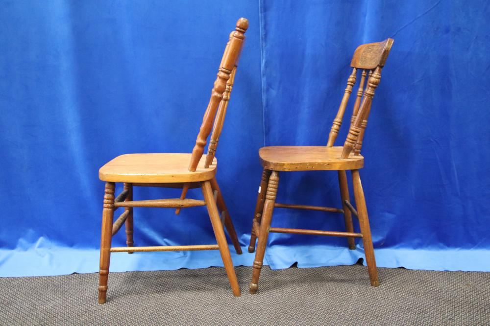 2 SPINDLE BACK KITCHEN CHAIRS WITH KANGAROO MOTIF NEED WORK