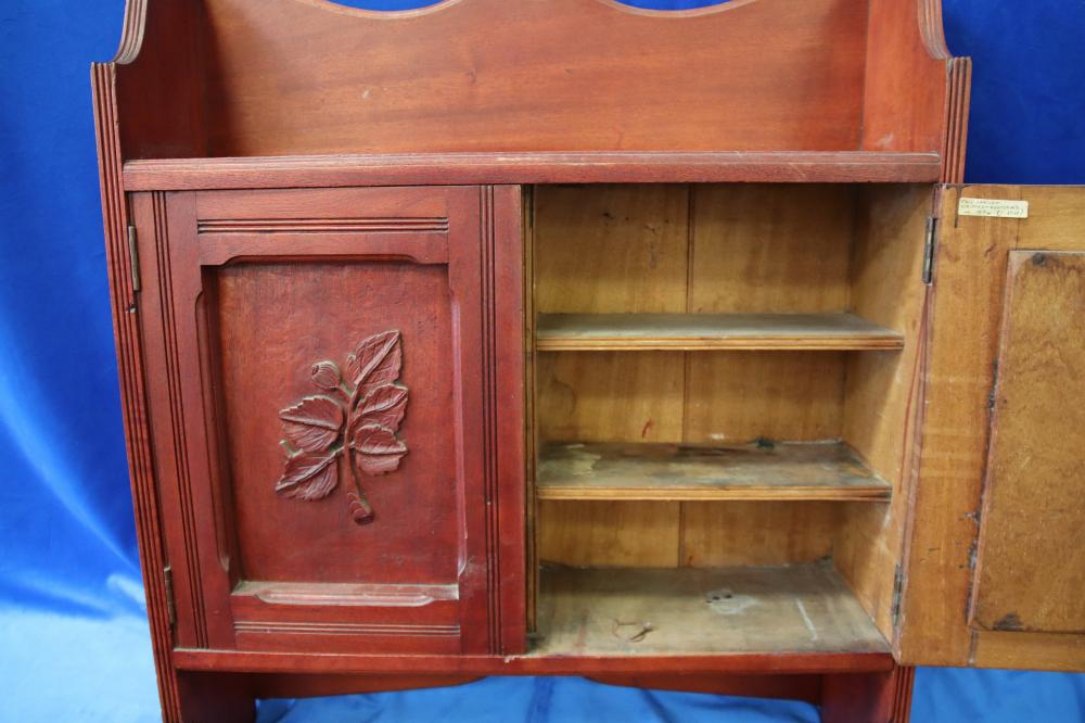 TIMBER WALL HANGING CUPBOARD WITH CARVED DETAIL ON THE DOORS