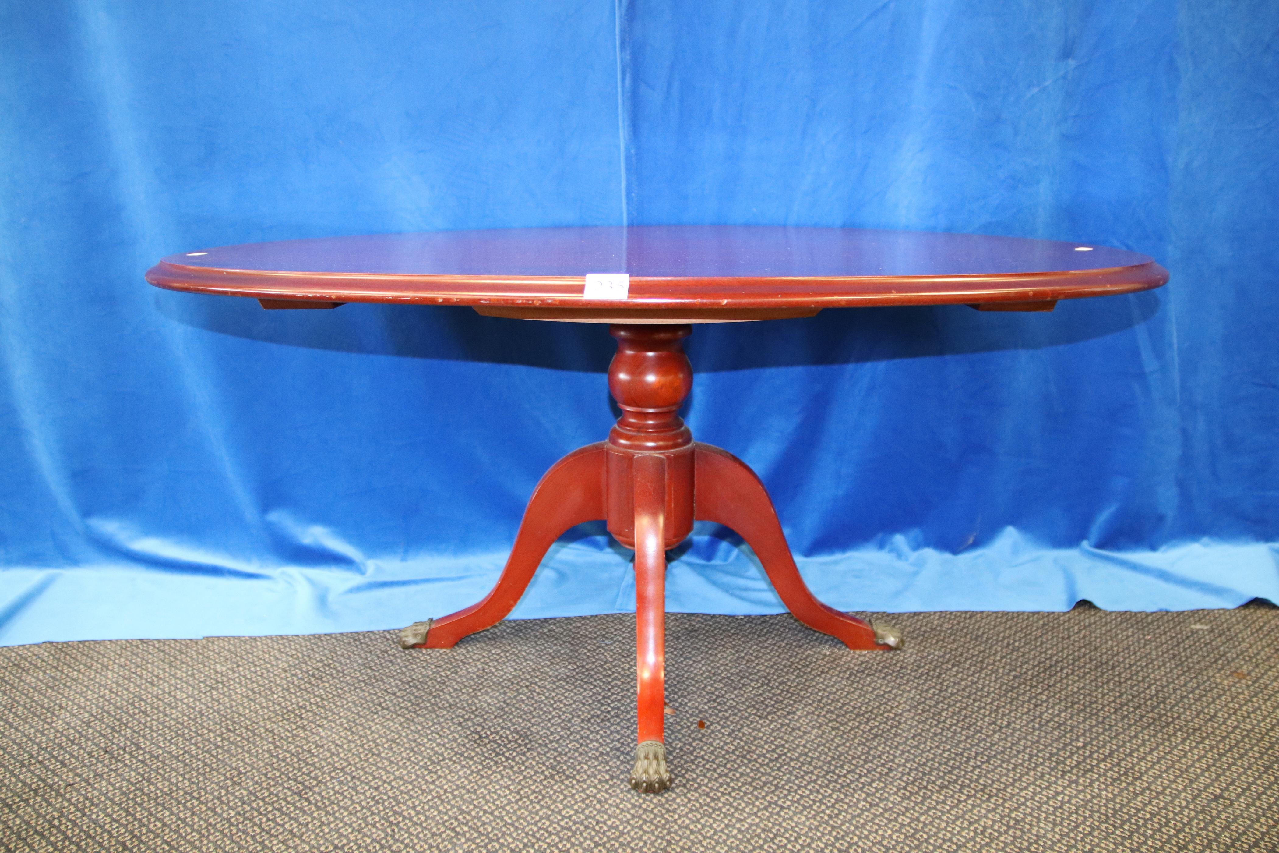 CLAW FOOTED OVAL COFFEE TABLE