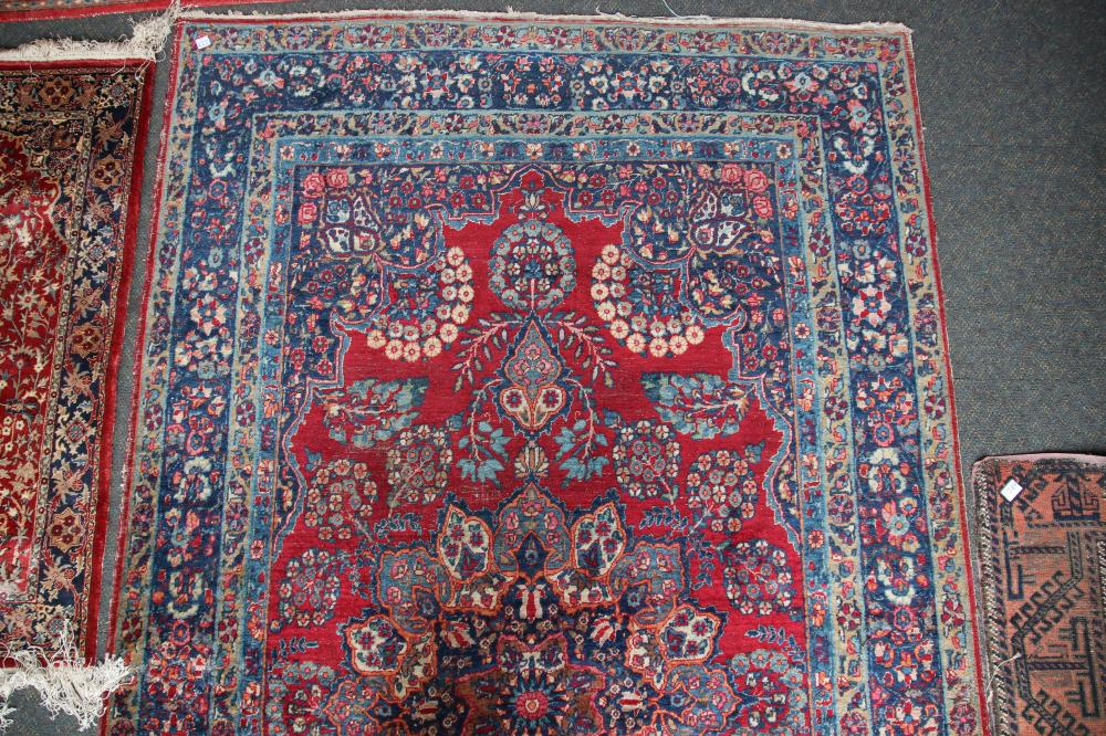 ANTIQUE PERSIAN HAND KNOTTED WOOL FLOOR RUG, RED AND BLUE MEDALLION AND BORDER PATTERN, MEASURES 156CM X 270CM (WEAR AND FRAYED EDGES)