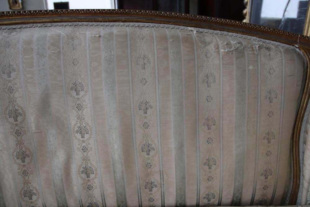 FRENCH LOUIS XV STYLE GOLD GILT CURVED BERGERE SOFA, GOLD WOODEN FRAME WITH FABRIC COVERING (FABRIC IN AVERAGE CONDITION) WITH 3 HAND CUSHIONS, CIRCA 1910'S, MEASURES 195CM W X 98 CM H AND 43CM H TO SEAT