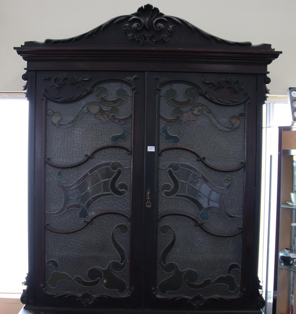 ENGLISH ART NOUVEAU PERIOD (1880-1920) MAHOGANY LIBRARY BOOKCASE, WITH APPLIED HAND CARVED DECORATIONS, LEAD LIGHT DOORS TO THE TOP, 4 DOORS, ADJUSTABLE INTERNAL WOODEN SHELVES, MEASURES, 122CM W X 45CM D X 244CM H (3 PIECES)