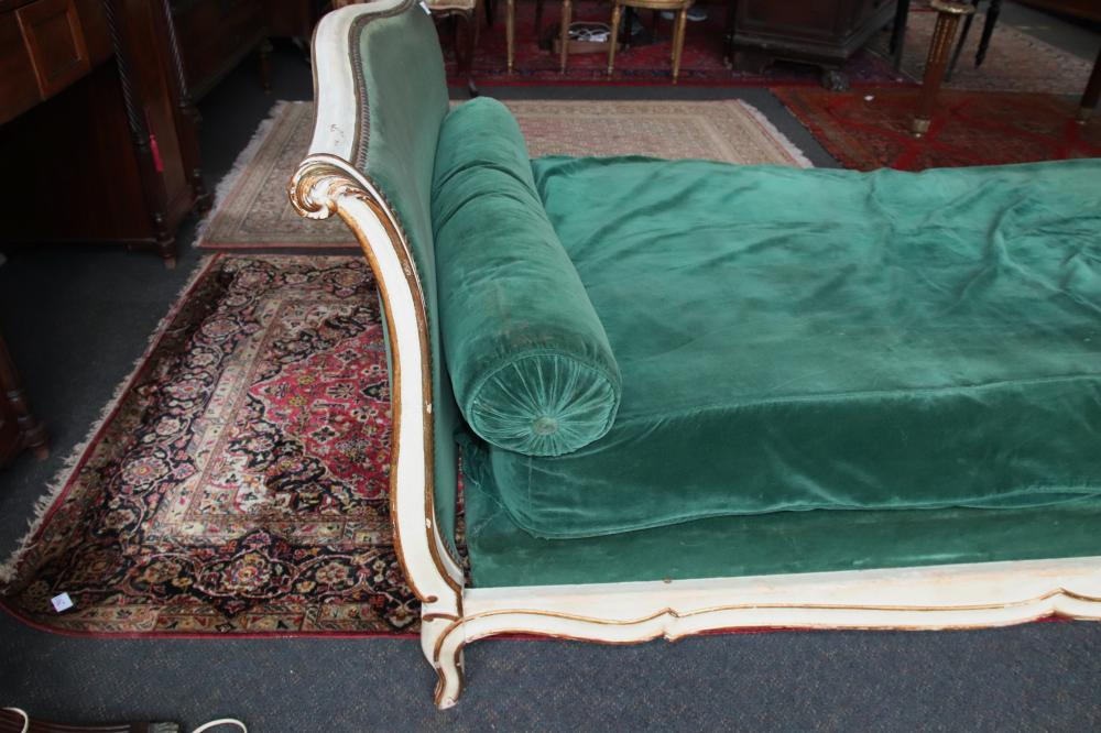 FRENCH LOUIS XV STYLE DAY BED, WHITE PAINTED WITH GOLD OVERLAYS, CIRCA 1910'S, 230CM L X 108CM W, WITH GREEN MATTRESS, AND MATCHING CUSHIONS,