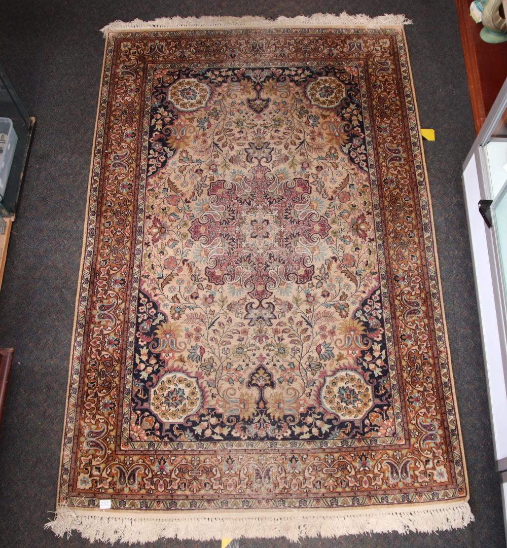 ANTIQUE HAND KNOTTED FLOOR RUG, SILK AND WOOL, CREAM AND BROWN MEDALLION WITH FLORAL PATTERN BORDER, MEASURES 182CM X 122CM (WEAR)