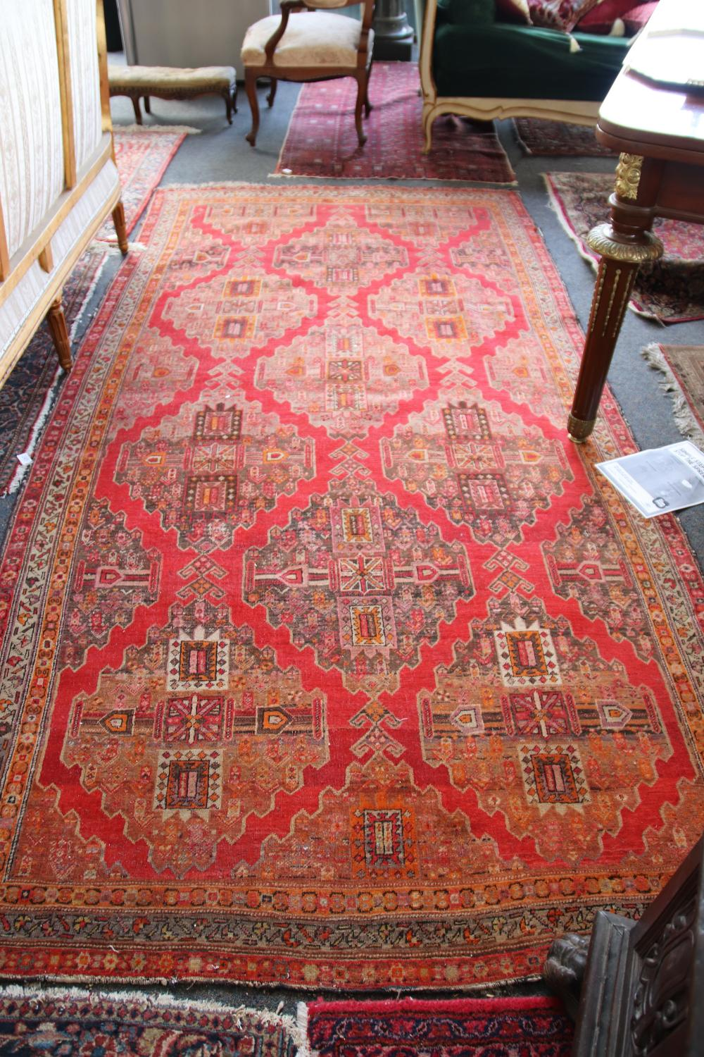 ANTIQUE PERSIAN HAND KNOTTED WOOL FLOOR KILIM, RED, ORANGE AND BROWN MEDALLION AND BORDER PATTERN, MEASURES 150CM X 300CM (WEAR AND FRAYED EDGES)