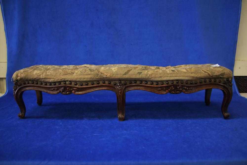 FRENCH OAK FRAMED FOOTSTOOL WITH TAPESTRY COVERING (POOR CONDITION), CIRCA 1920'S, MEASURES 90CM W X 20CM H X 24CM D