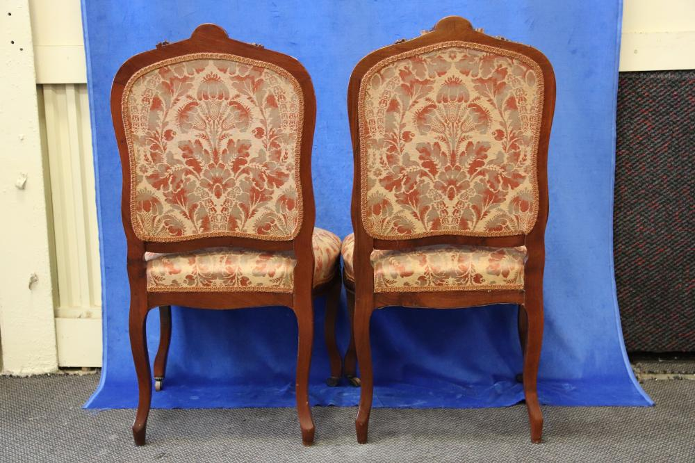 PAIR OF FRENCH LOUIS XV STYLE BEDROOM CHAIRS, HAND CARVED WALNUT FRAME, PEACH AND GOLD FABRIC UPHOLSTERY, CIRCA 1920'S