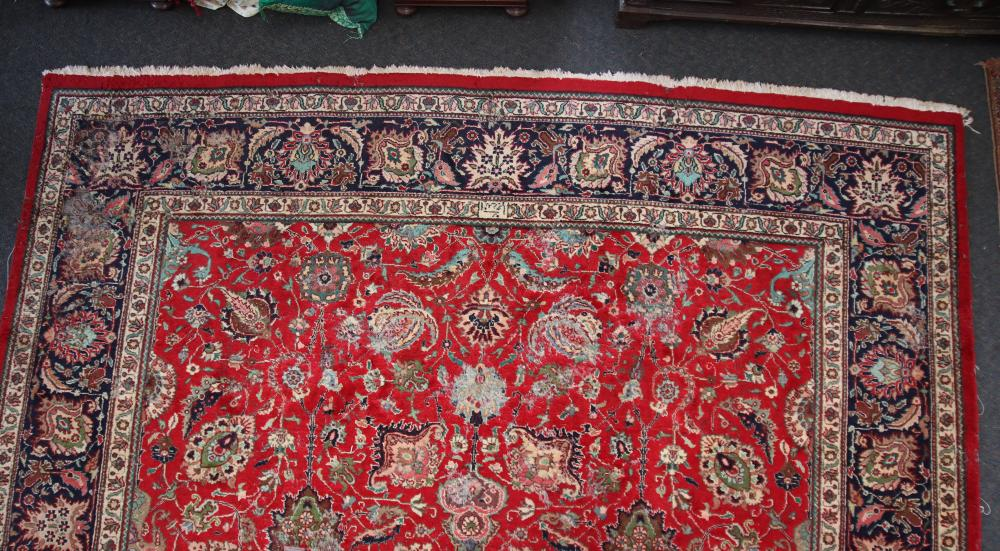 LARGE ANTIQUE HAND KNOTTED WOOL FLOOR RUG, RED, BLUE AND CREAM MEDALLION AND BORDER PATTERN, MEASURES 400CM X 296CM (HEAVY WEAR AND FRAYED EDGES)