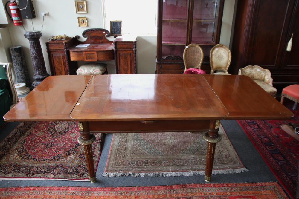 LOUIS XV STYLE FRENCH MAHOGANY EXTENSION DINING TABLE, ORMOLU MOUNTS, COLLARS AND INSERTS TO LEGS, DRAW LEAF EXTENSIONS, CIRCA 1890'S, MEASURES 110CM W X 136CM L AND 252CM L WHEN FULLY EXTENDED,