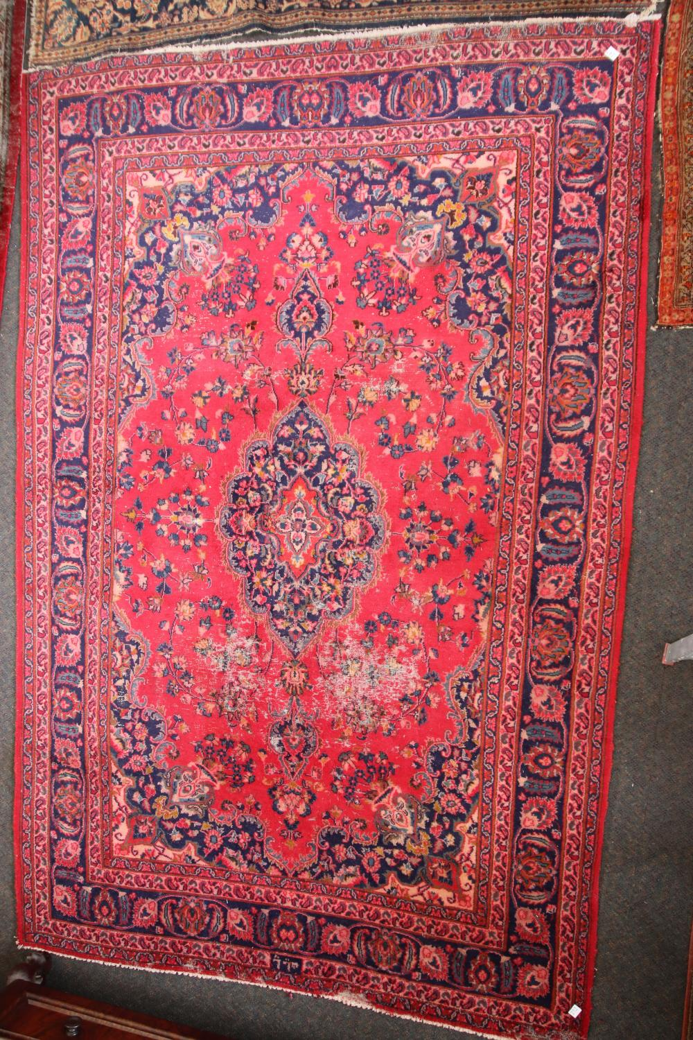 LARGE ANTIQUE HAND KNOTTED WOOL FLOOR RUG, RED AND BLUE AND MEDALLION AND BORDER PATTERN, MEASURES 190CM X 290CM (WEAR AND DYE RUNNING)