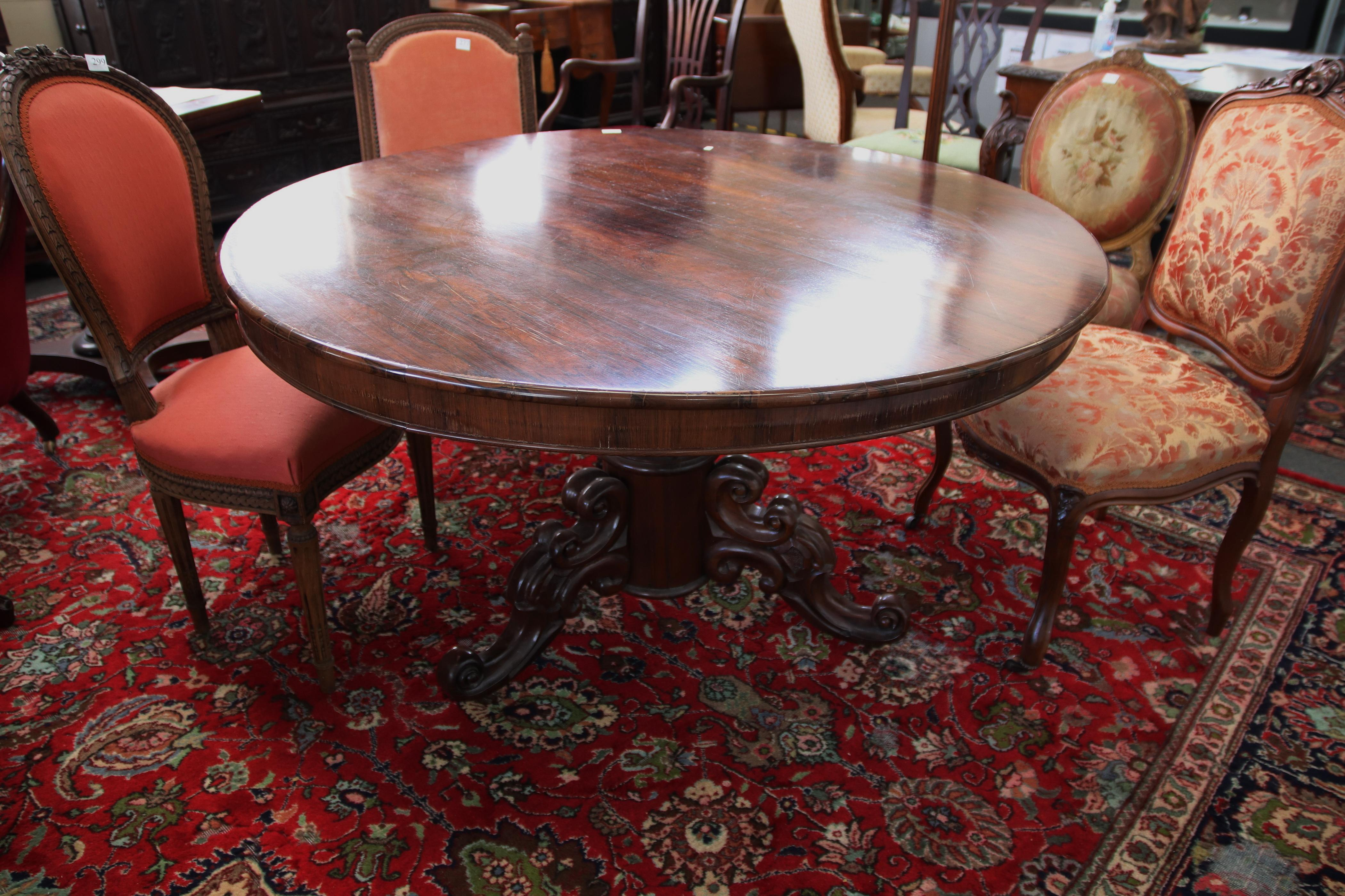 19TH CENTURY ENGLISH ROSEWOOD ROUND DINING TABLE, WITH HEAVILY CARVED TRI-FOOTED BASE, DIAM 128CM DIAM X 73CM H (SPLIT DOWN GLUE LINE ON TOP)