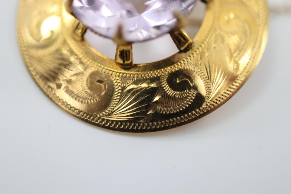 9 CARAT GOLD BROOCH WITH LARGE AMETHYST 34 MM DIAMETER, MADE IN 1970, VALUATION $1445 (2018), 9.2 GRAMS TOTAL WEIGHT