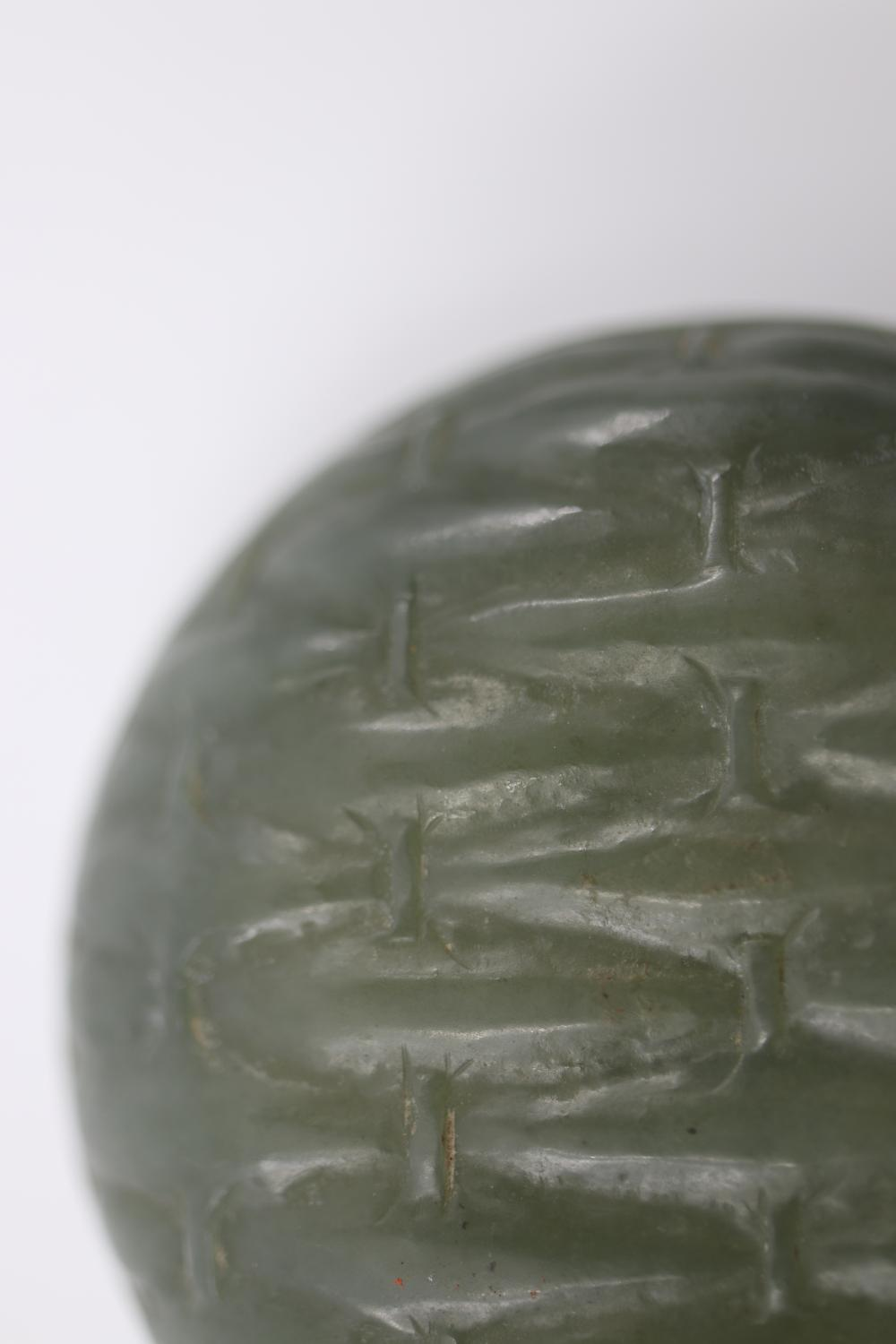 FINELY CARVED ROUND CELADON JADE PASTE BOX ON WOODEN STAND, WOVEN BAMBOO PATTERN TO LID AND BASE, QING DYNASTY, 47 GRAMS, MEASURES 5CM DIAM X 2CM H
