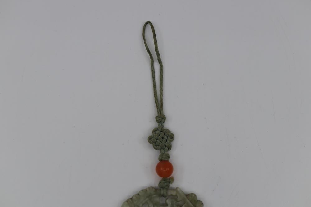 FINELY CARVED CHINESE LIGHT GREEN/WHITE JADE PENDANT FEATURING BIRD IN BRANCHES, MEASURES 6CM L X 4CM W WITH TASSELS, 18 GRAMS, QING DYNASTY