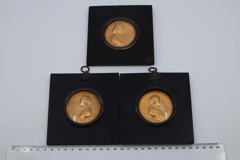 3 X FRAMED ROUND VICTORIAN MINIATURES, GILDED METAL PORTRAITS INC JOHN FLETCHER, MARKED M & P, 55MM DIAM - BLACK FRAME ON ONE A/F CONDITION