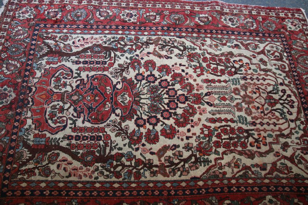 ANTIQUE PERSIAN HAND KNOTTED WOOL FLOOR RUG, RED AND BLUE MEDALLION AND BORDER PATTERN, MEASURES 146CM X 200CM (WEAR AND FRAYED EDGES)