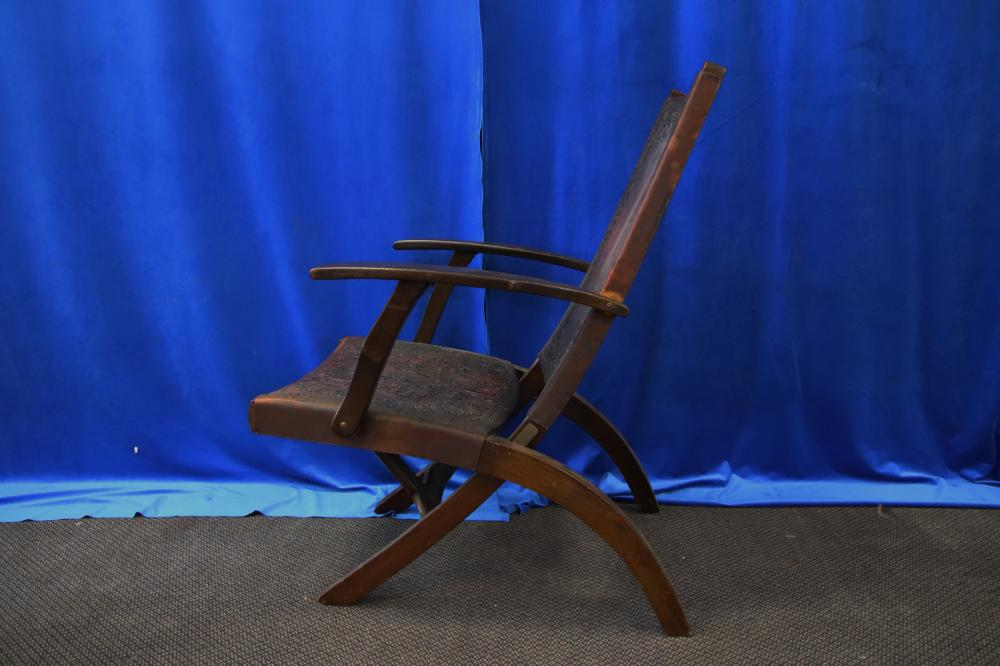 PAIR OF PERUVIAN FOLDING TIMBER CHAIRS WITH EMBOSSED LEATHER COVERING AND TIMBER FRAME