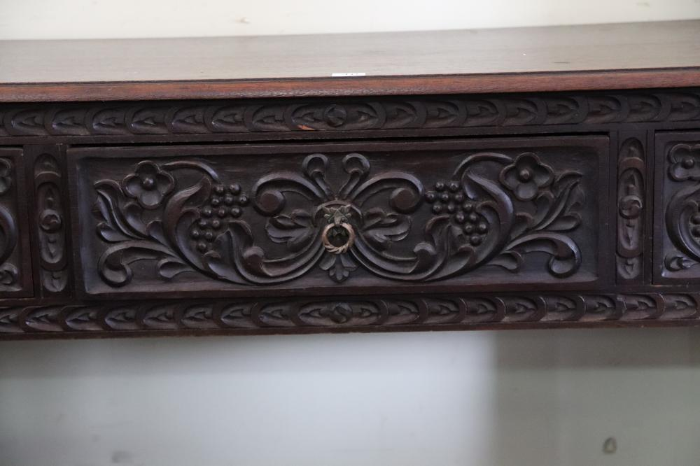 PERUVIAN CARVED TIMBER SIDE TABLE THE THREE DRAWERS WITH GRAPE MOTIF, 130CM W X 50CM D X 80 CM H