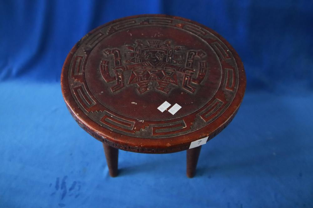 EMBOSSED LEATHER TOP RECTANGULA COFFEE TABLE WITH INCA MOTIFS AND A MATCHING PAIR OF ROUND STOOLS , PAPER STUCK ON TOP OF COFFEE TABLE ( TABLE LEGS NEED REPAIR)