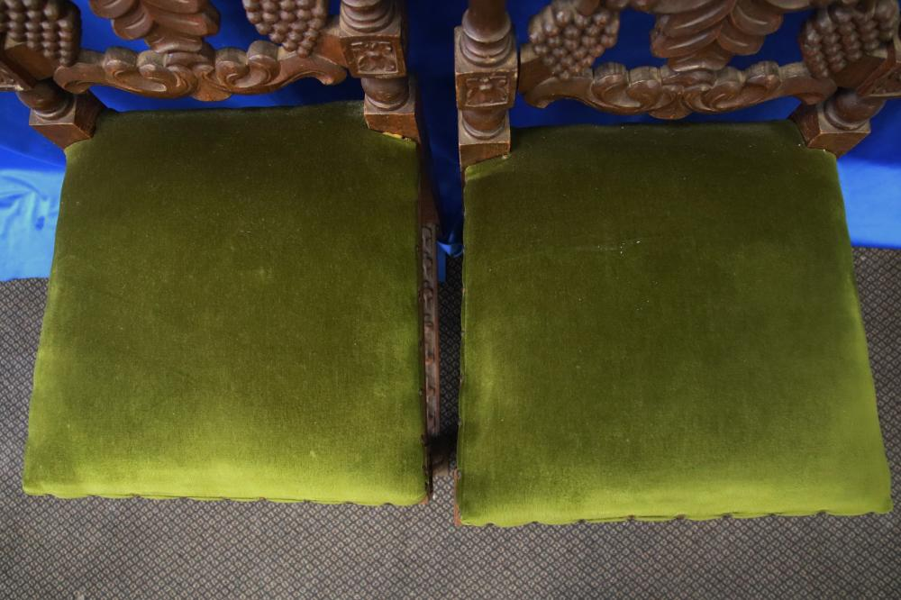 PAIR OF PERUVIAN BAROQUE STYLE HIGH BACK CHAIRS THE BACKS WITH GRAPES & GREEN VELVET SEATS