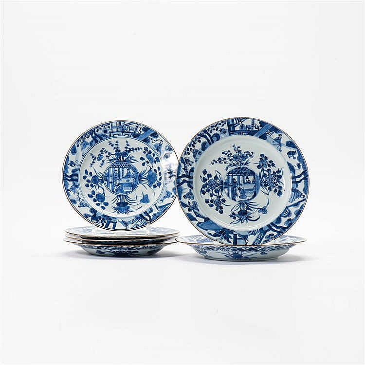 A series of four blue and white plates and a pair of matching plates