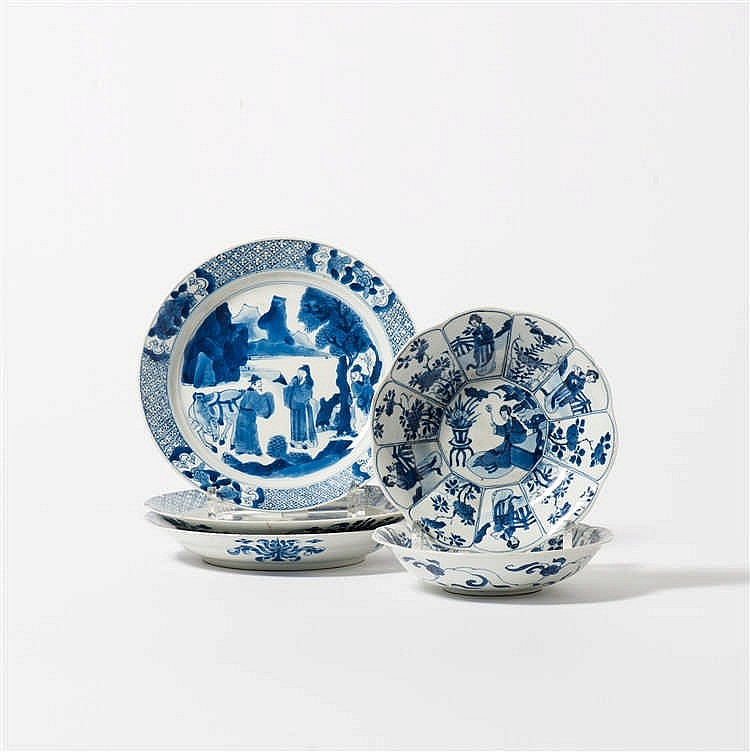 A pair of blue and white dishes and a series of three blue and white plates