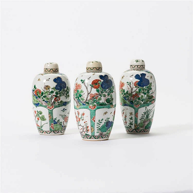 A series of three egg-shaped 'famille-verte' vases with lids