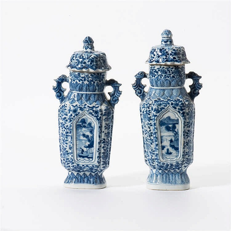 A pair of curved blue and white lidded vases