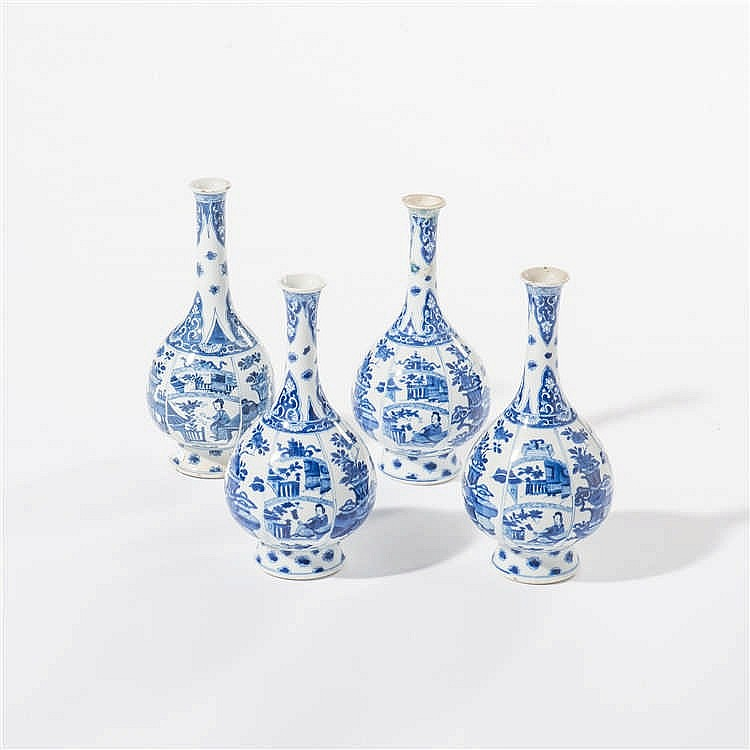 A series of four blue and white vases