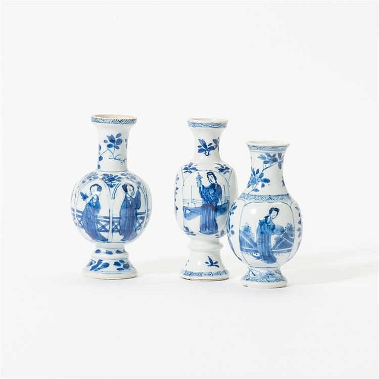 Three curved blue and white vases