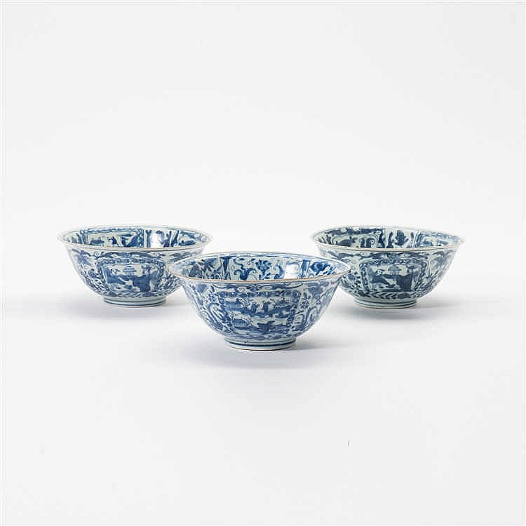 A series of three blue and white bowls