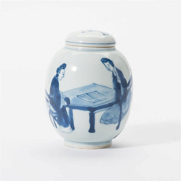 An egg-shaped blue and white lidded pot