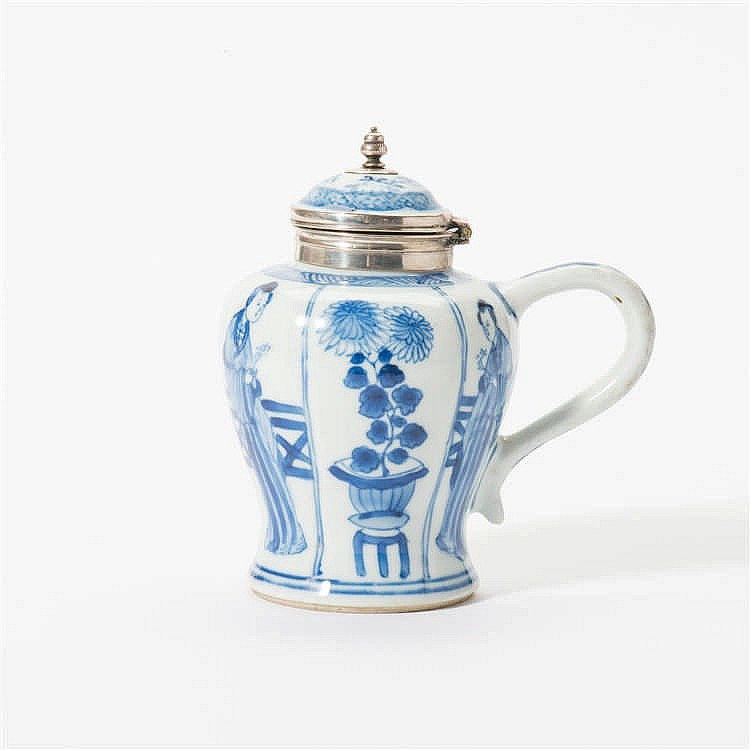 A blue and white mustard pot with hinged lid