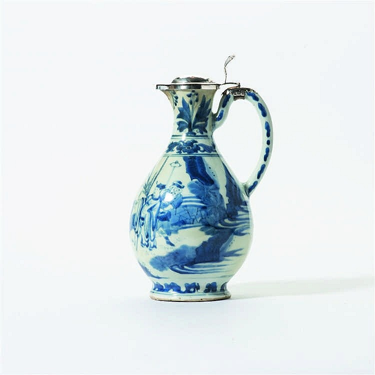 A pear-shaped blue and white jug