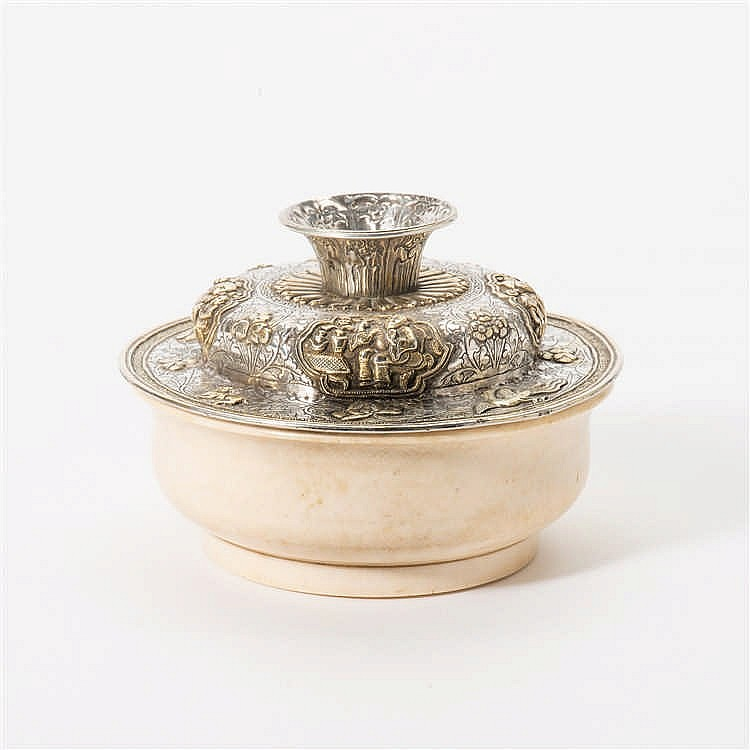 A turned ivory tea bowl with silver lid
