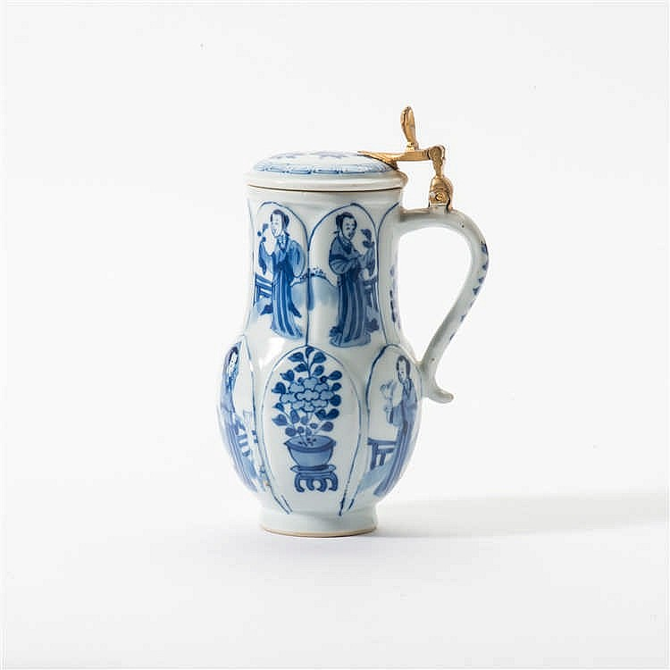 A curved blue and white jug with hinged lid