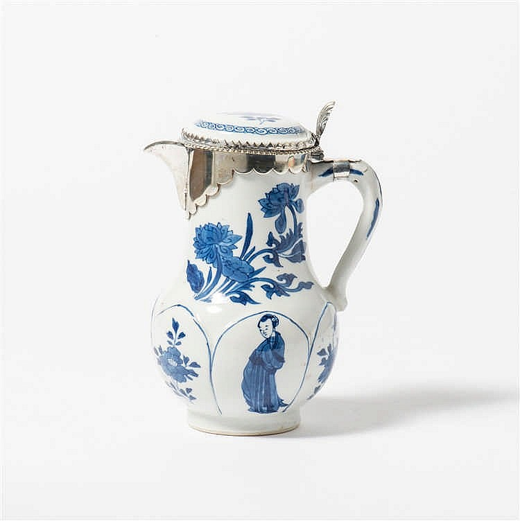 A blue and white jug with hinged lid