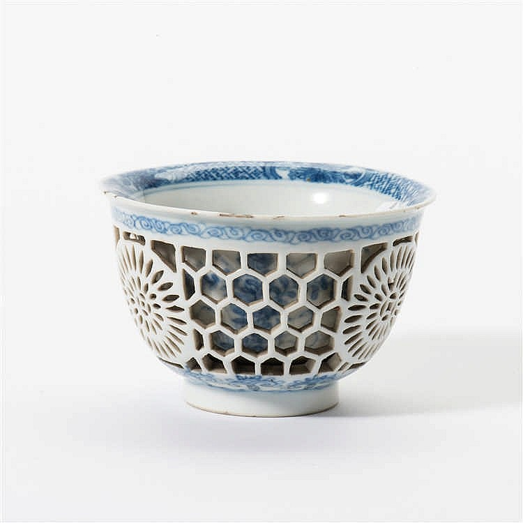 A double-walled openwork blue and white cup